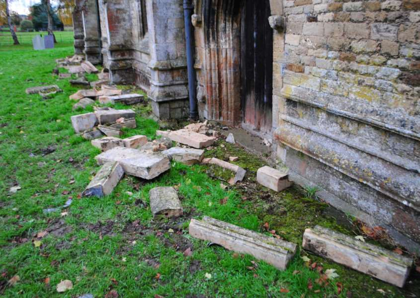 Masonry broken off All Saints Church Hougham while lead was stolen from the roof.