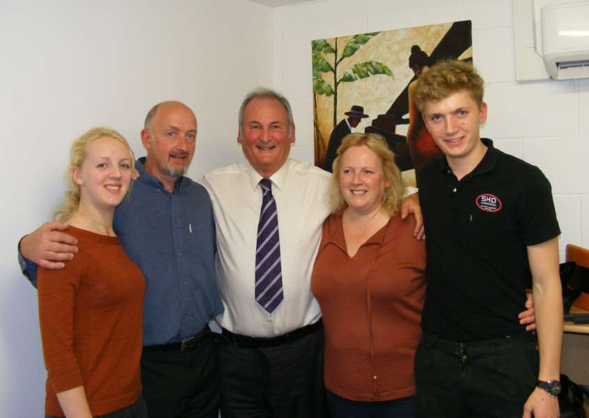 Richard Noble (centre) with Steve and Helen Doughty and family at SHD in Sleaford. EMN-151010-122949001