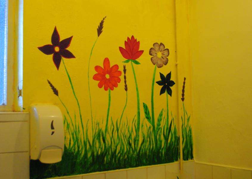 The group used their creative skills to paint the clients toilets in bright colours.