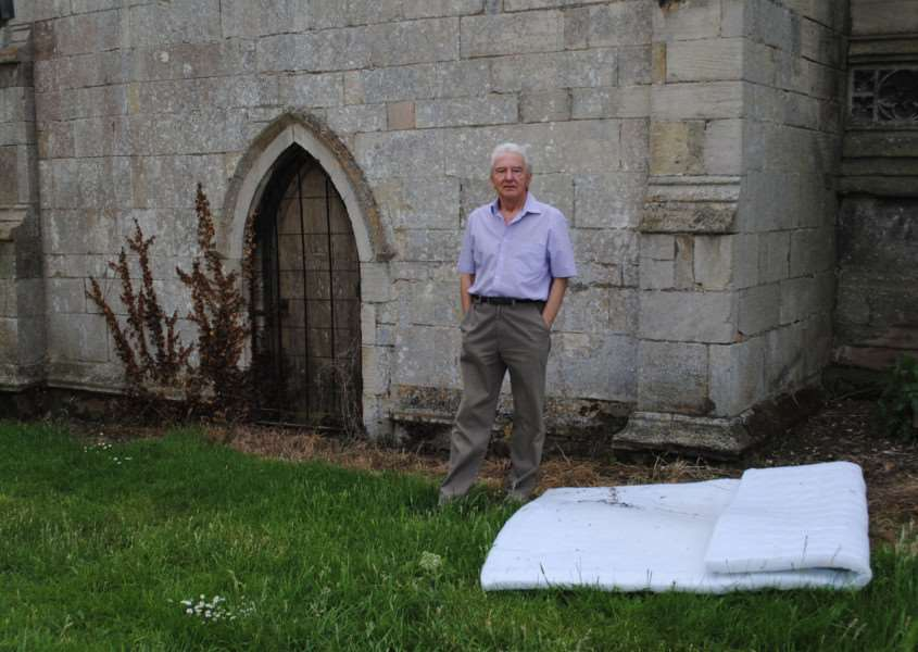 Church warden Bryan Bargh with the discarded mattress.