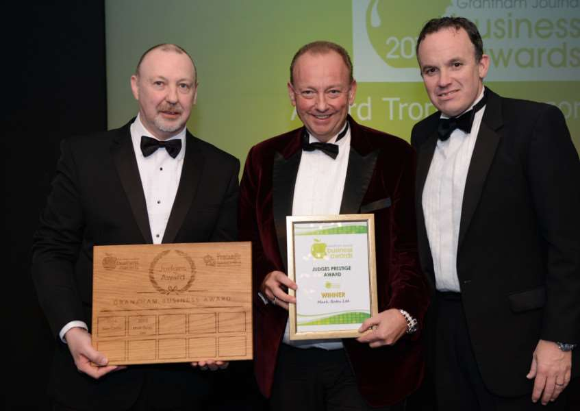 Mark Bates, centre, receives the Judges' Excellence Award from Nigel Rivers of sponsors Pentangle Engineering, left, and Grantham Business Club's Stuart Pigram.