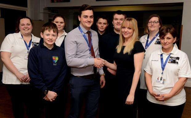 Headteacher of Ambergate, James Ellis with Grantham manager of the Yorkshire Bank, Hannah Martin. (6302010)