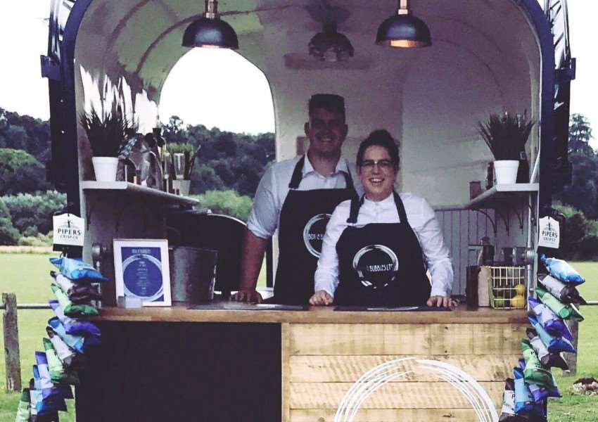 Lauren and Adam Gray in their Prosecco bar converted from a horse box.
