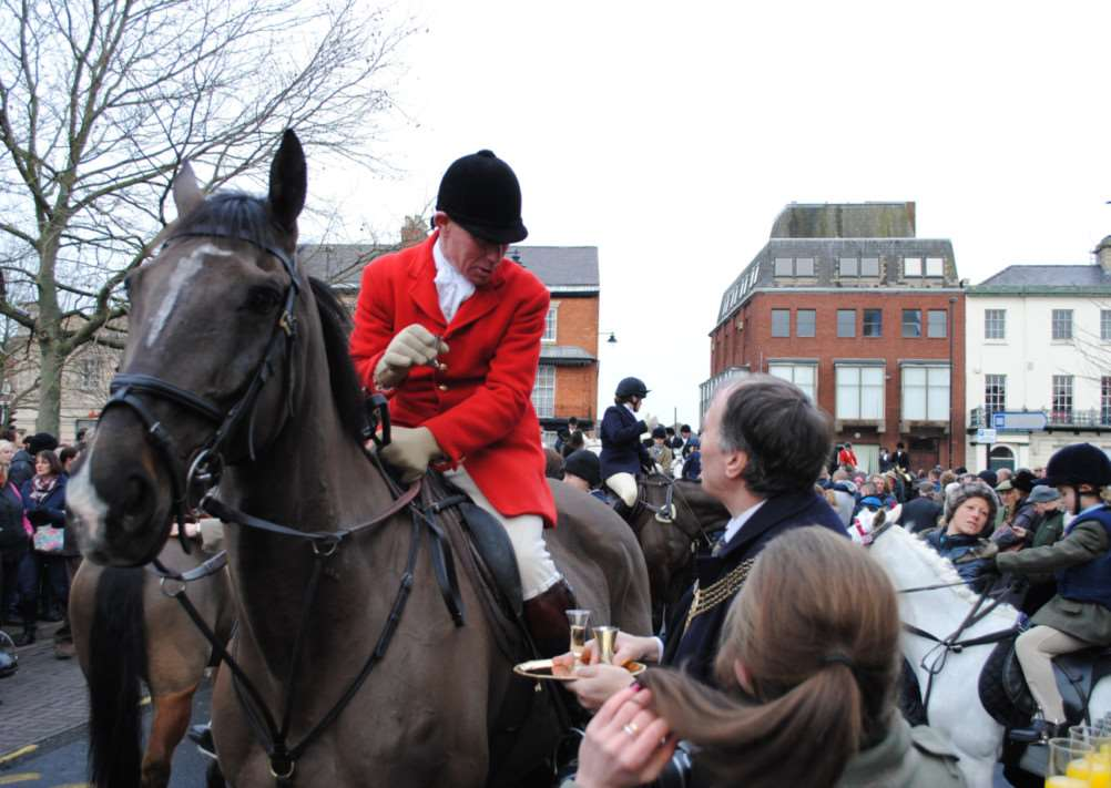 The Belvoir Hunt is greeted by the Mayor of Grantham Ian Selby at the Boxing Day meet in St Peter's Hill.