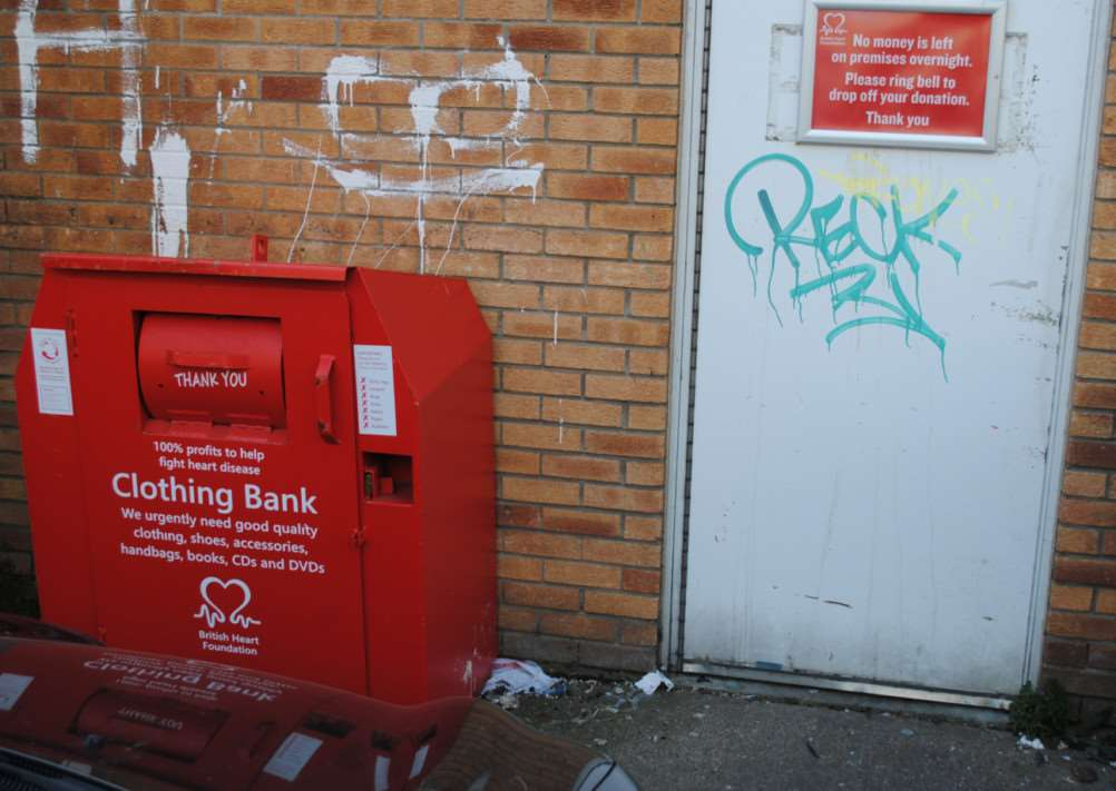 The door next to the donation bank where the human faeces was deposited and smeared.