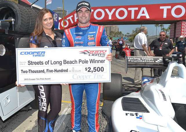 Jack Harvey receives some monetary reward for qualifing in pole position at Long Beach, California.