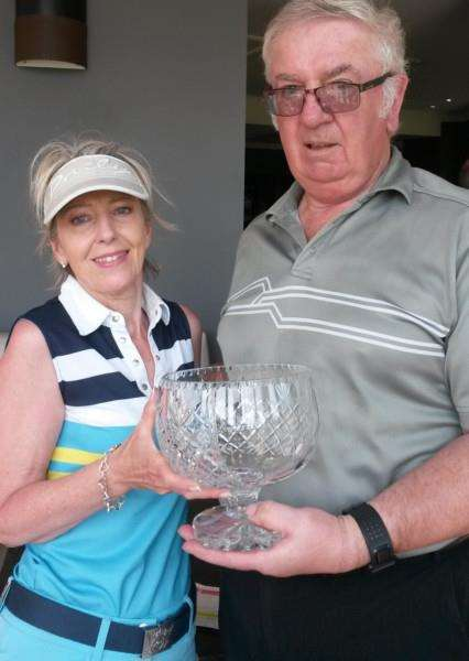 Lorraine Robertson receives the Belton Woods Past Captains' Trophy from George Forbes.