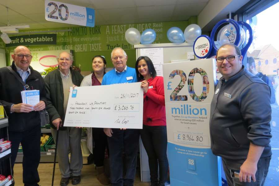 At the presentation to Parkinson's UK at the Dysart Road Co-op are, from left, Richard Rogers, Brian Bothamley, Natasha Green, Raymond Flack, vice-chairman Grantham Branch, Natalia Ciukaj, and manager of the Dysart Road Store, Steve Caughtry