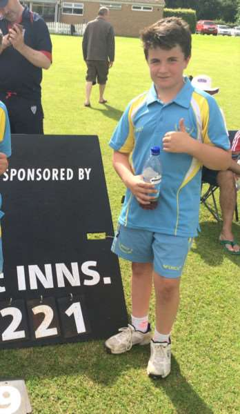 Joe Dickinson alongside his South Lincs U12 side's imposing score.