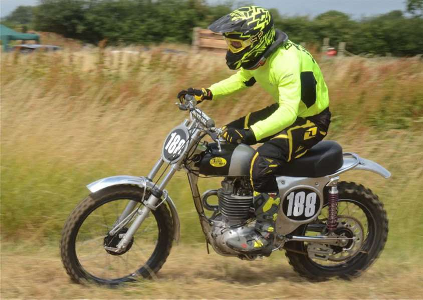 Double classic moto cross champion Aaron Graves seen here on a BSA single is rushing to get a mighty twin cylinder Triumph-BSA twin ready in time for Sproxton on Sunday.