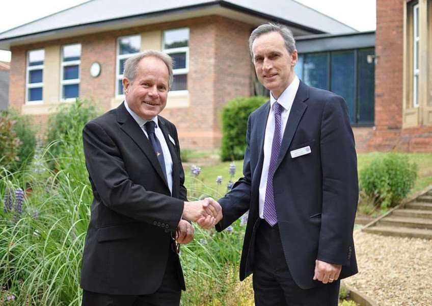Left, Graham Burks hands over to David Scott, the new headteacher of Kesteven and Grantham Girls' School.