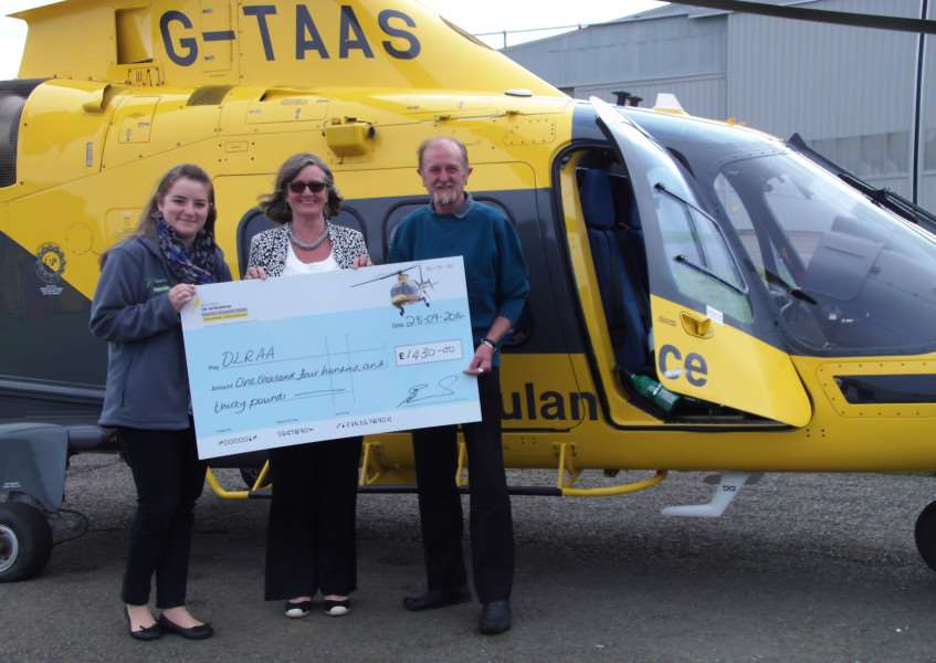 The Crown Inn landlords Anna and Alan Edmunds present a cheque for �1,430 to a charity representative of the Derbyshire, Leicestershire'and Rutland Air Ambulance PHOTO: Supplied