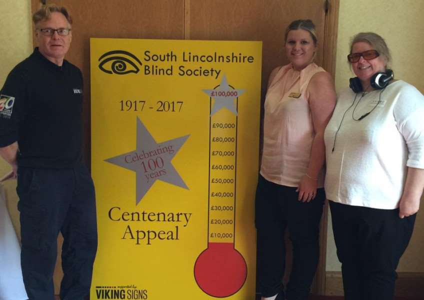Appeal Totaliser donated by Viking Signs, represented by Duncan Hood, with South Lincolnshire Blind Society chair Sarah Carter and executive member Kate Cottier.