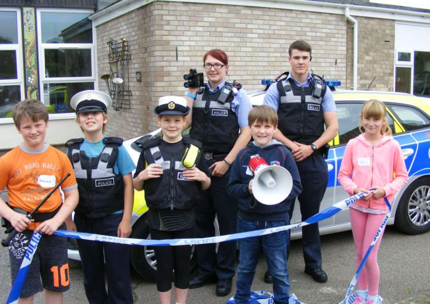 Youngsters with RAF Police Cpl Rachel Free and Cpl Billy Smith. EMN-160623-105608001