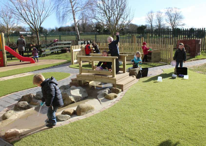 Children at the nursery enjoying the new outdoor area.