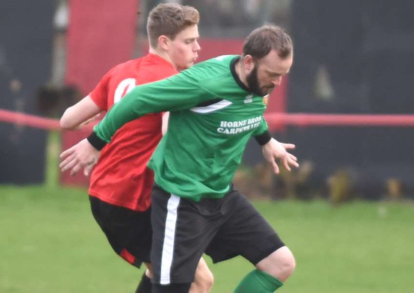 Harrowby United man of the match Danny Durkin tussles with a Sleaford Town opponent. Photo: Toby Roberts