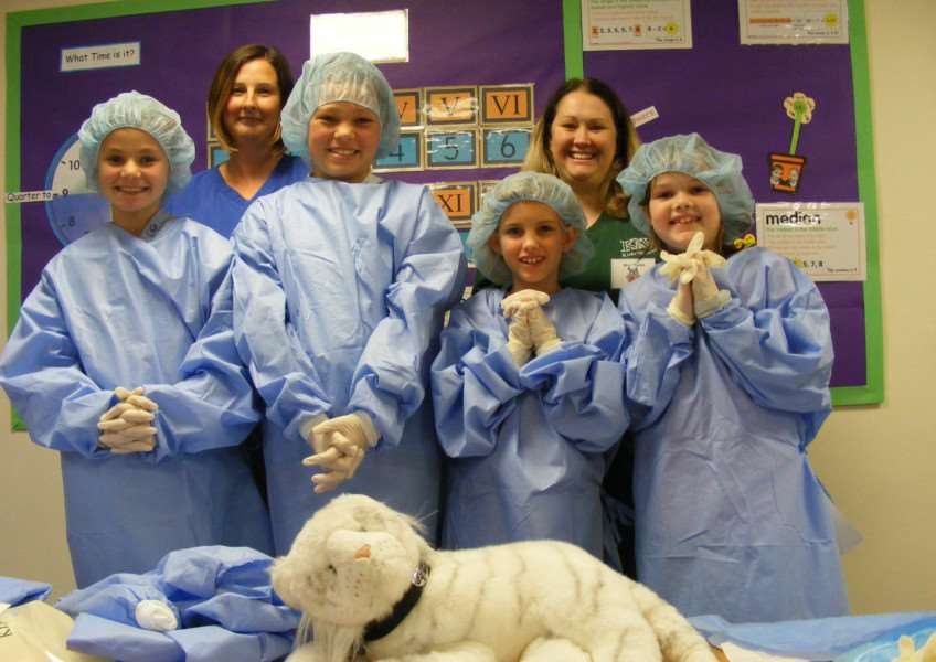 Joanne Mercer - nursing assistant and Karen Tholen - lead nurse from Kirks Vets with children about to 'operate'. EMN-160623-105555001