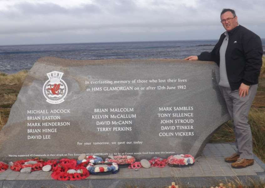Phil Davy next to the memorial on the Falkland Islands to those shipmates who died on HMS Glamorgan in 1982.