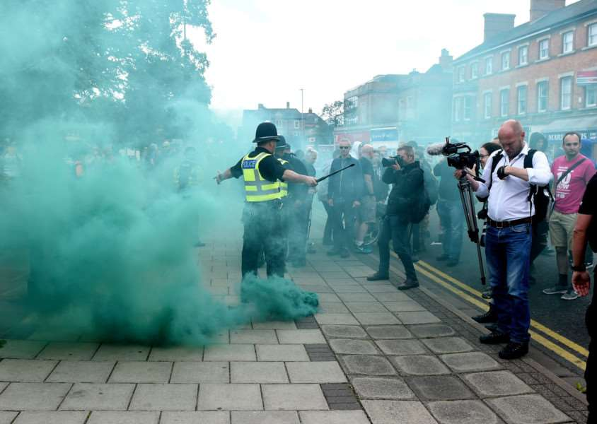 Violence as National Front and Unite Against Fascism members collide.