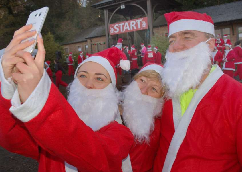 Time for that Santa selfie for the Davies family PHOTO: Tim Williams