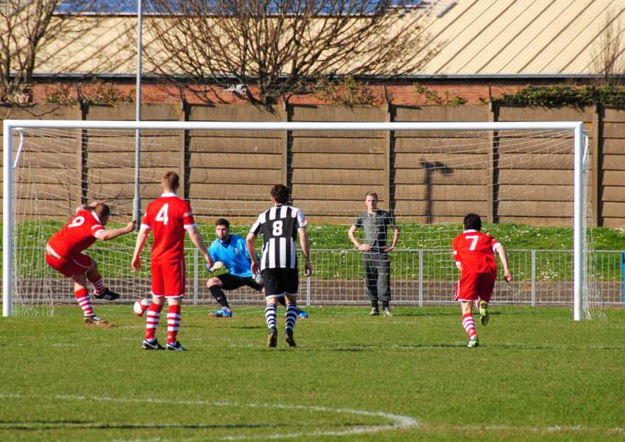 Greg Smith's penalty was saved by Grantham keeper Jake Turner. Photo: John Burgess