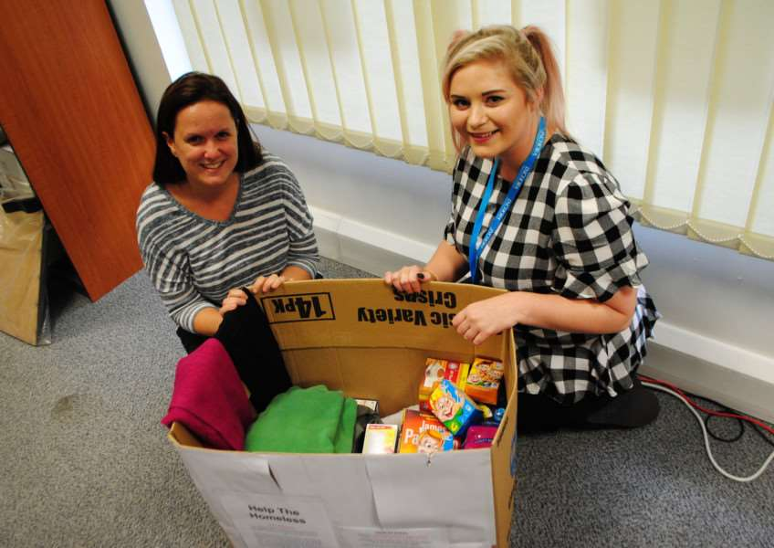 Journal reporter Tracey Davies (left) presents Katie-May Moore with the Journal's donations.