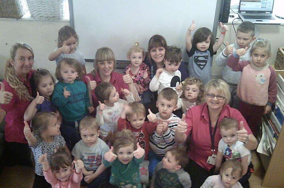 Staff and children celberate their 'good' Ofsted report.