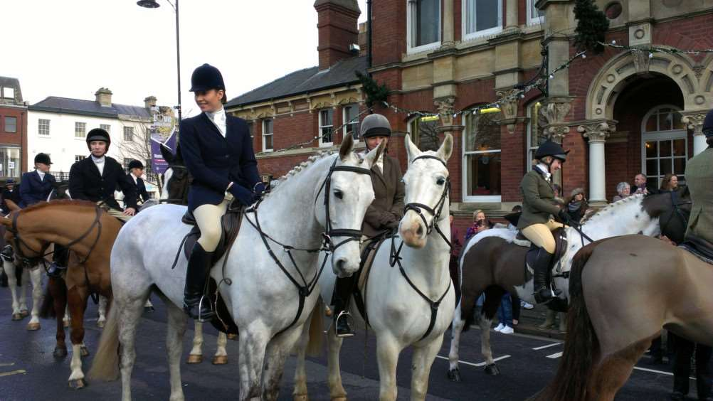 The Belvoir Hunt arrives in St Peter's Hill in Grantham on Boxing Day.