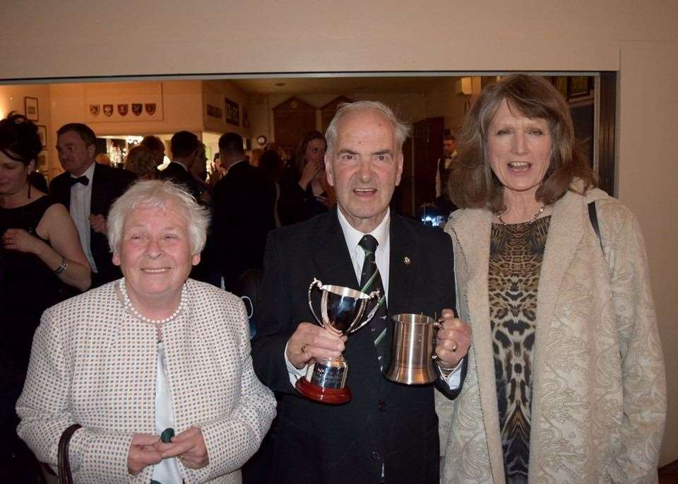 Kesteven club secretary Bill Berridge, alongside his wife Sheena, receives the Derrick Smith Cup from Belinda Smith. (10825429)