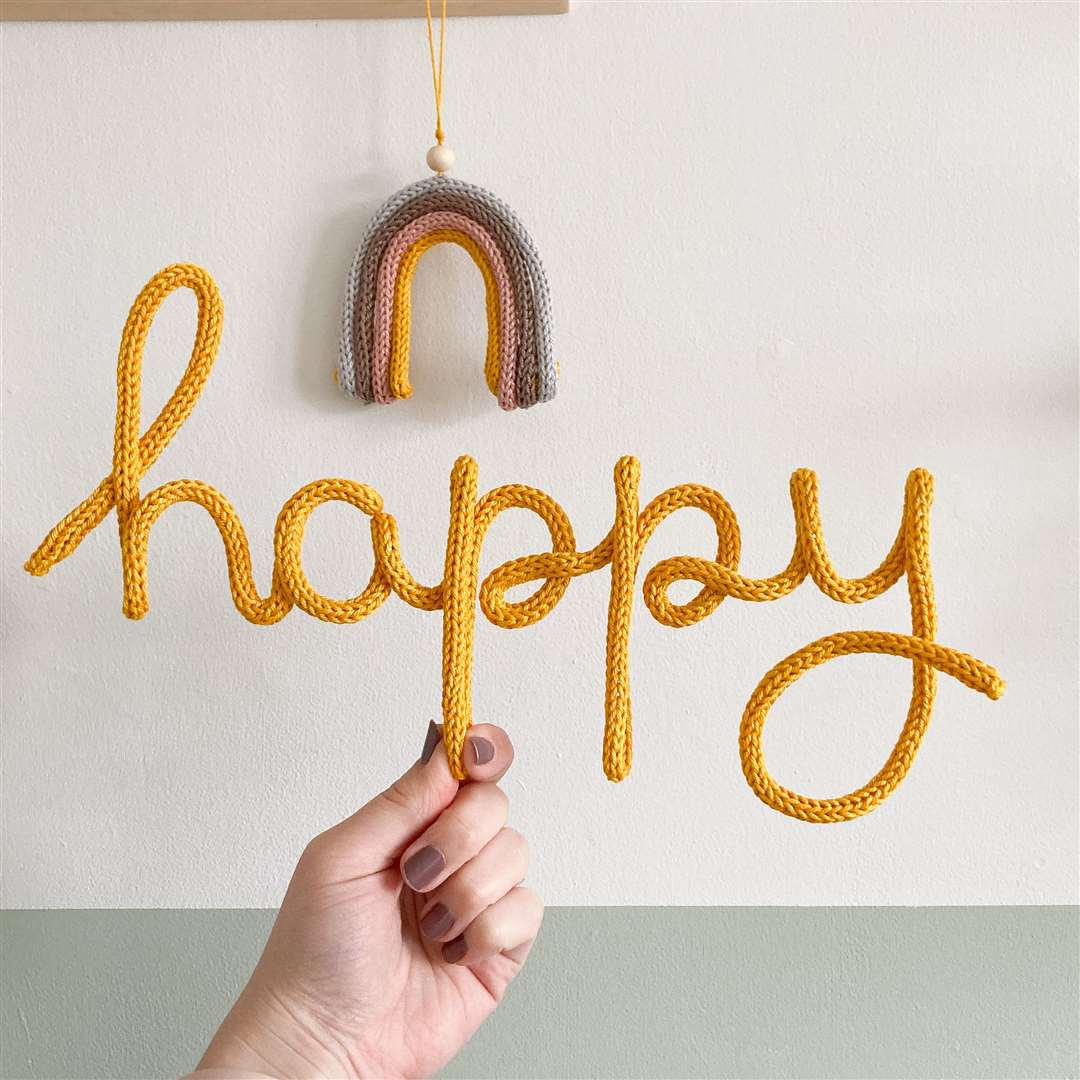 Katie creates knitted wire words as personalised gifts. (44995027)