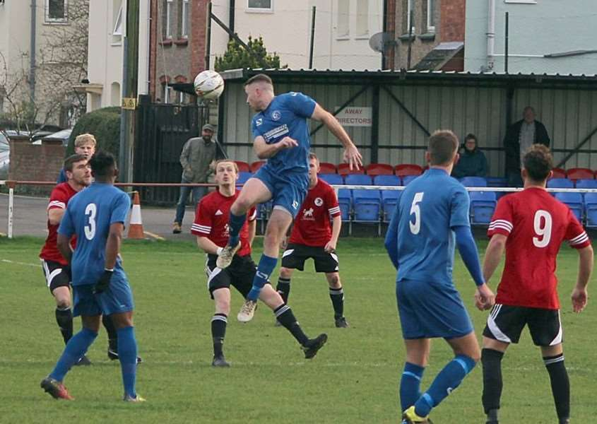 Joe Briers gets up to win a header for Harrowby United on Saturday.