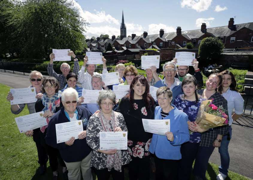 Volunteers and organisers with their certificates . Copyright Anglian Water.