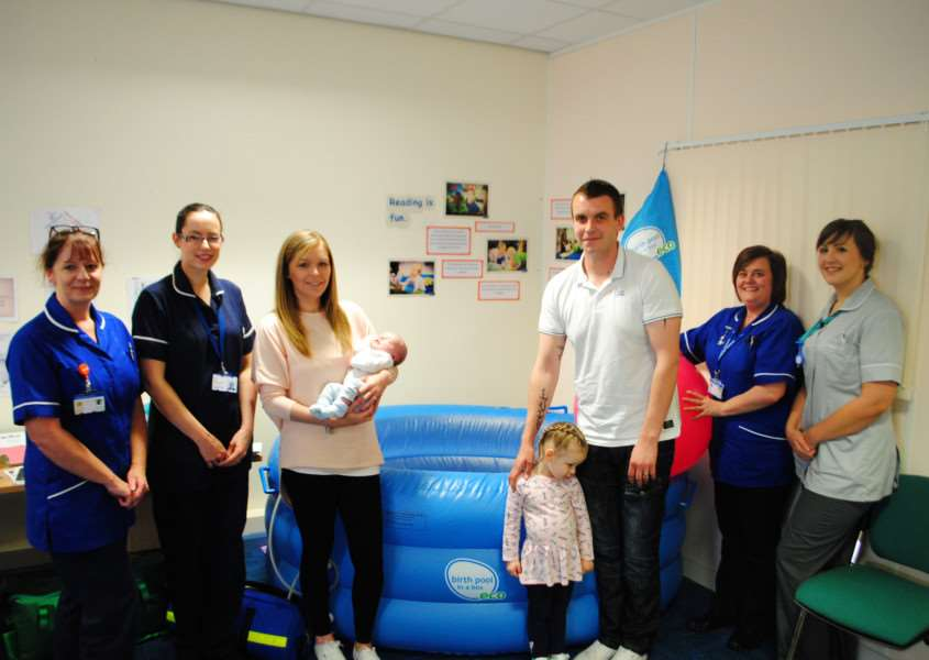 The Carter family donates a birthing pool to the Home Birth Group at Belton Lane Children's Centre in Grantham.
