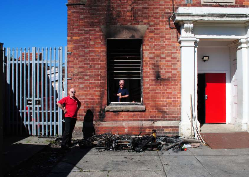British Heart Foundation warehouse manager Steve Bebbington and volunteer Christopher Wakefield survey the damage cause by the fire at the back of the Grantham store.