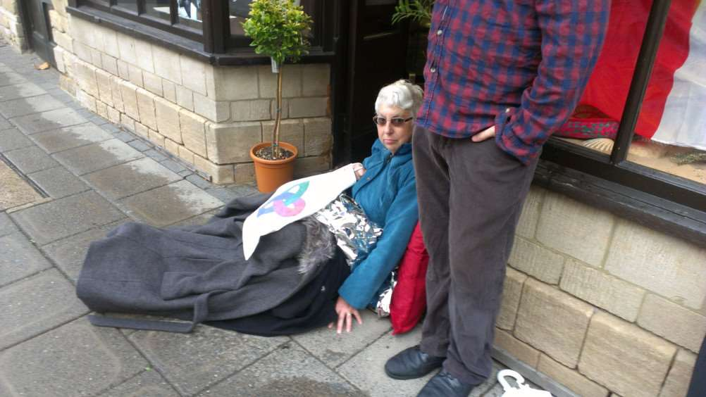 Catherine Allen, 66, waits for ambulance on Grantham High Street.