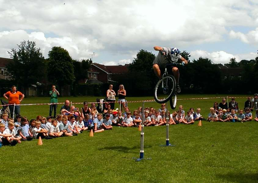 Stunt biker Danny Butler clears the high bar with a dramatic bunny hop. EMN-160629-160718001