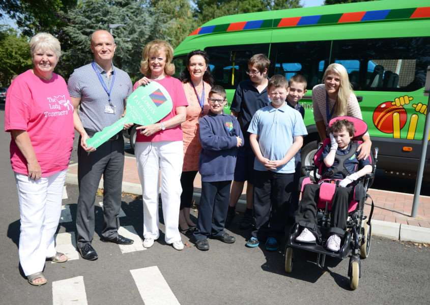 At the presentation of the minibus to Grantham Additional Needs Fellowship are, from left, Jenny Noble, of Lincolnshire Ladies Taverners,'Paul Stevens, Sandon School principal, Yvonne Wood, of Lincolnshire Ladies Taverners, and Jacki Batram, of GANF with pupils.