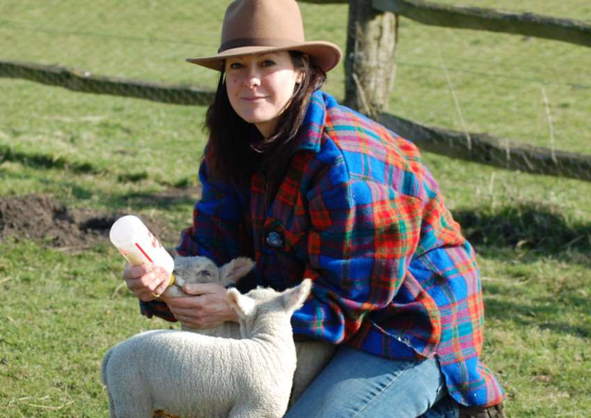 Sophie Arlott feeds one of her lambs.
