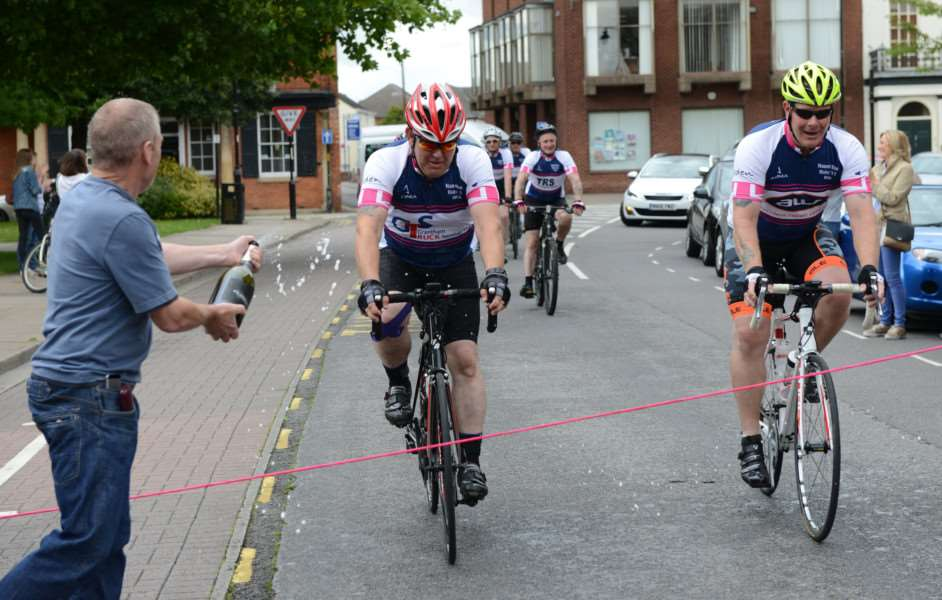 Time to celebrate. Riders in the Naomi Fund Bike Challenge are welcomed back to Grantham.