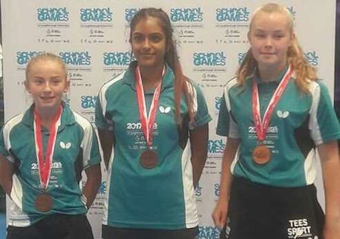 Bronze medallists Darcie Proud (left), Mollie Patterson (right), and Midlands team-mate Bhavika Mistry.