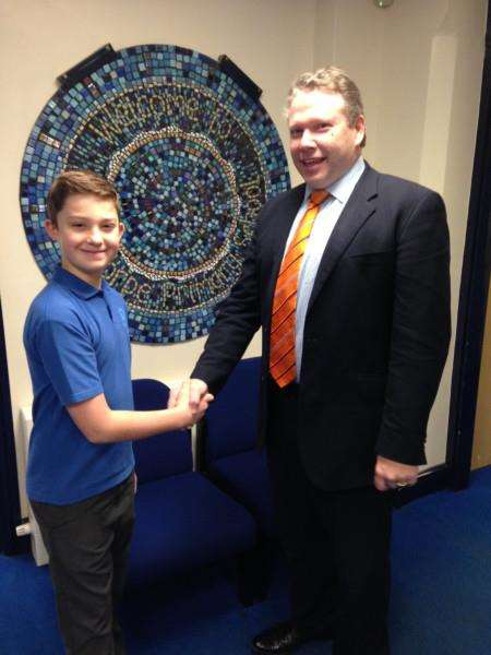Year 6 pupil Finn Bennett, of Caythorpe School, meets Lincoln MP Karl McCartney after writing to him at the House of Commons.