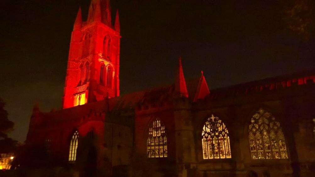 St Wulfram's Church tower in Grantham has been bathed in red light as part of Remembrance.
