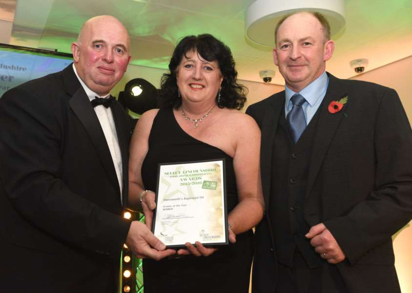 Success: Cllr Colin Davie, left, presents the Grower of the Year award to Ronnie and Andrew Ownsworth. Picture: Anna Draper.