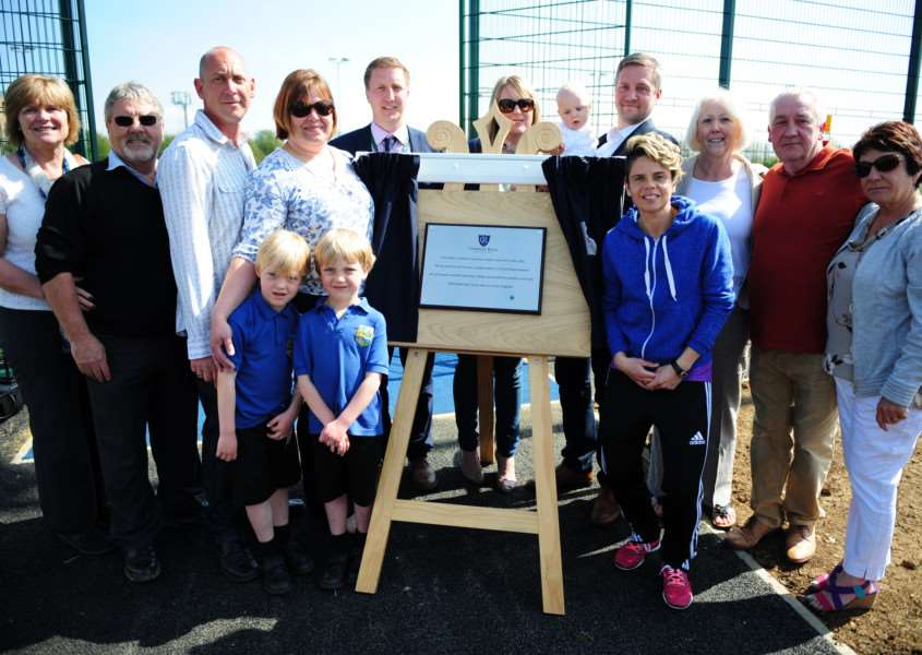 The family of Bailey Drew, Principal Mr Sloan and England International Footballer Sue Smith at the official opening of the new 3G all-weather pitch at Charles Read Academy.