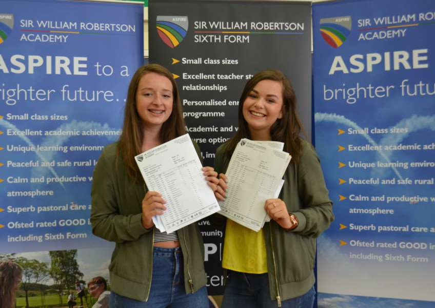 Millie Randall from Wellingore and Molly Burgess from Navenby are happy with their GCSE results at Sir William Robertson Academy.