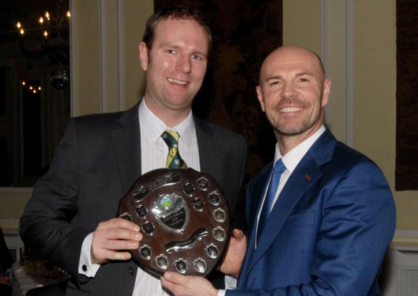 Dan Webb receives Grantham CC's Lincs ECB Premier League runners-up trophy from former England international Paul Nixon. Photo: Nigel West