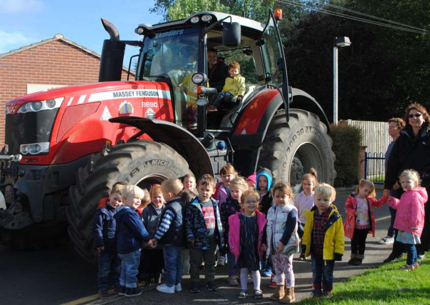 Children at Bottesford Pre-School got a visit from a farmer and his tractor this morning.