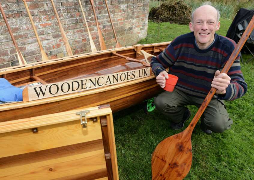 Alick Burt showed off his handmade wooden canoes