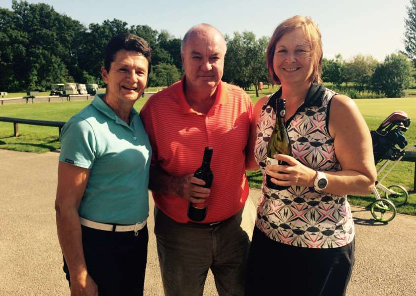 Tony Rose Bowl winners Carole Stothard and Les Stewart with Belton Woods lady captain Wendy Stewart.