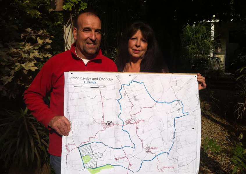 Roger Higginbotham and Jo Morris-Turner are ready for a fight against plans for a solar development. EMN-141011-090428001